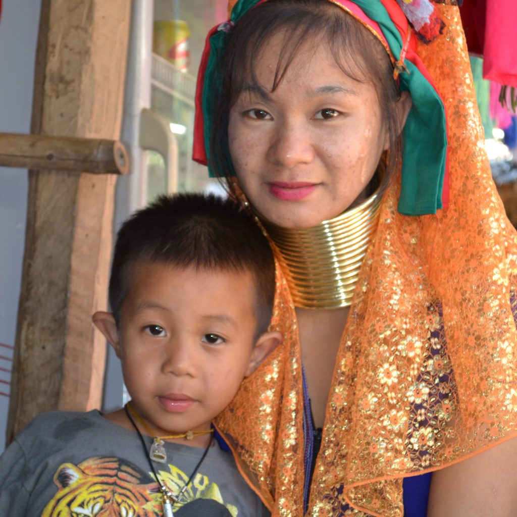 This Is Maway With Her Son. Maway Was Very Hospitable And Welcoming By Letting Us Stay In Her House In Huay Sua Thao. She Told Us That She Frequently Invites Tourists To Stay At Her House And Also Other Women In The Village Do This. So There Is A Form Of Homestay, Only There Is No Marketing For It. Maway's Husband Works, Next To Other Jobs In Gardening And Construction, In A Rice Field Next To The Village. So They Have Income All-year Round. Her Daughter Also Wears The Rings, But Only In Holidays Because The Rings Irritate While Playing. Maway Is A Proud Woman: She Is Proud Of Her Culture And Rings And Likes To Dress Herself Colorfully. Photo By: Joney Habraken